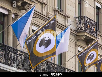 Zurich, Switzerland - September 25, 2017: facade of the Hotel Schweizerhof decorated with flags of Zurich Film Festival. Zurich Film Festival takes pl - Stock Photo