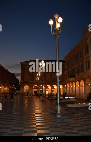 Night time in the Place Massena in Nice France with lighted art - Stock Photo