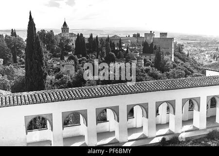Black and white view across the cityscape of Granada from the Generalife Gardens in Andalusia Spain - Stock Photo