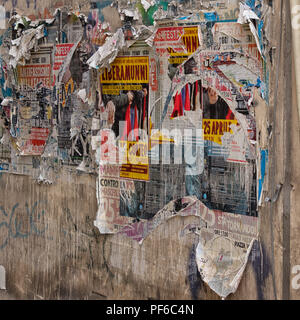 PALERMO,  SICILY:  Old torn posters on wall - Stock Photo
