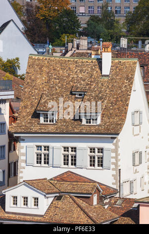 Zurich, Switzerland - September 27, 2017: buildings of the historic part of the city of Zurich as seen from the Lindenhof park. Zurich is the largest  - Stock Photo