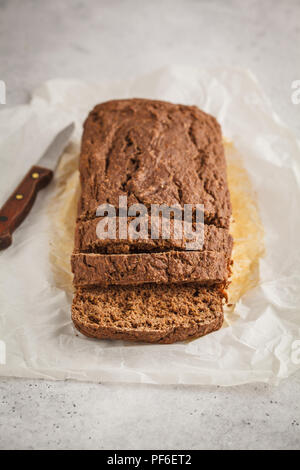 Chocolate vegan zucchini bread, white background. Clean eating concept. - Stock Photo