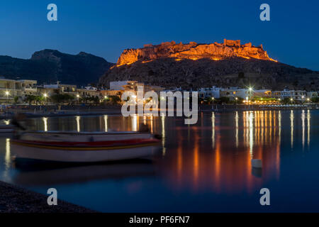 Blue hour at Haraki (Charaki) overlooking the harbor and the castle in the distance, Rhodes Island, Greece - Stock Photo