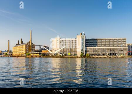 View across the river Spree to the University of Applied Sciences ( Hochschule für Technik und Wirtschaft - HTW) in summer 2018, Berlin, Germany - Stock Photo