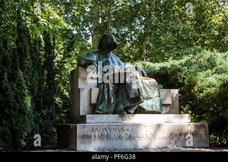 Budapest, Hungary. 14th August, 2018. Miklós Ligeti's statue of Anonymus, the first medieval Hungarian chronicler, in Vajdahunyad Castle courtyard. - Stock Photo