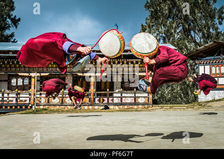Monks practising the Black Hat Dance at a monastery near Chamkar, Bhutan - Stock Photo