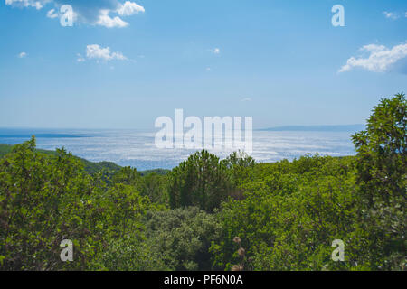 Gallipoli sunset panorama. Countryside, sea and Gallipoli island on horizon. Çanakkale, Turkey. - Stock Photo