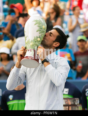 Mason, Ohio, USA. August 19, 2018: Novak Djokovic kisses the Rookwood Trophy at the Western Southern Open in Mason, Ohio, USA. Brent Clark/Alamy Live News - Stock Photo