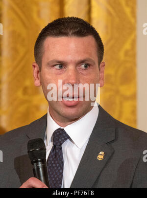 Washington, United States Of America. 20th Aug, 2018. Commissioner of United States Customs and Border Protection Kevin McAleenan speaks on a panel at an event hosted by US President Donald J. Trump titled a 'Salute to the Heroes of the Immigration and Customs Enforcement and Customs and Border Protection' in the East Room of the White House in Washington, DC on Monday, August 20, 2018. Credit: Ron Sachs/CNP | usage worldwide Credit: dpa/Alamy Live News - Stock Photo