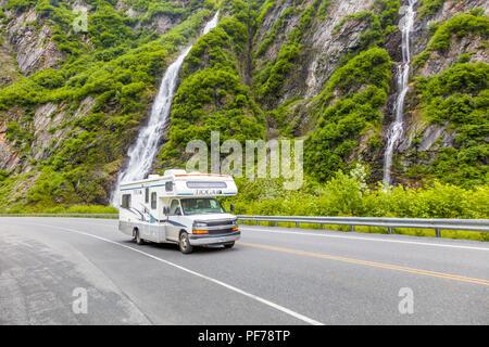 RV driving past waterfalls in Keystone Canyon on the Richardson Highway in Valdez Alaska