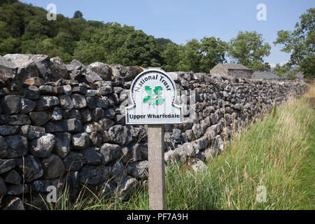 A national trust sign on the 'Dales Way' long distance footpath in the Yorkshire Dales ,England