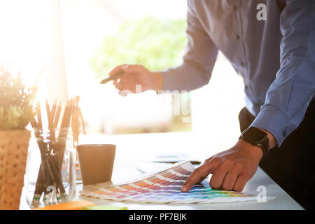 Cropped shot Graphic design and color swatches and pens on a desk. creative artist planning colour project. - Stock Photo