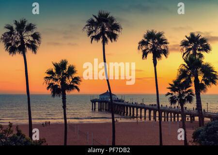 Manhattan Beach at sunset. Vintage processed. - Stock Photo
