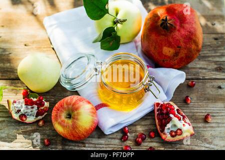 Apples, honey and pomegranate - Stock Photo