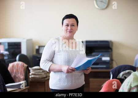 Belarus, Gomel, 25 April 2018. The office is central.Russian bureaucracy.Woman office worker with papers - Stock Photo
