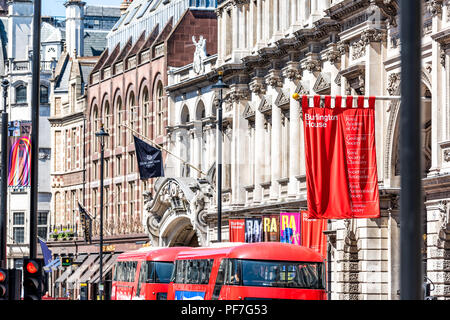 London, UK - June 22, 2018: The Royal Academy of Arts institution at Burlington House on Piccadilly Circus with Arcade, summer exhibitions banners adv - Stock Photo