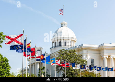 Montgomery, USA - April 21, 2018: Exterior state capitol building in Alabama during sunny day with old, historic architecture of government, green par - Stock Photo