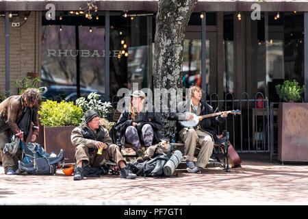 Asheville, USA - April 19, 2018: Downtown old town street in hipster North Carolina NC famous town, city with young hippie millennial people homeless  - Stock Photo