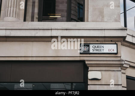 London, UK - July 24, 2018: Street name sign on a side of a building on Queen Street in the City of London, London's famous financial district. - Stock Photo
