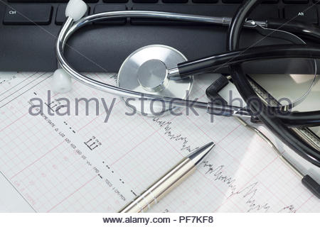 Stethoscope on the keyboard illustrating the medical industry / Medical information concept - Stock Photo