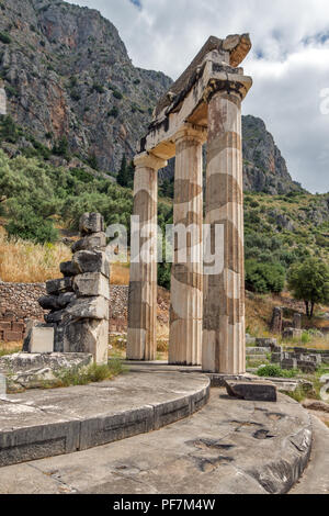 Ruins of Athena Pronaia Sanctuary at Ancient Greek archaeological site of Delphi, Central Greece - Stock Photo