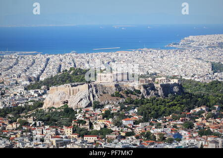 View over the city and the Acropolis from Lycabettus hill in Athens, Greece. Panorama of Athens . Beautiful cityscape with seashore - Stock Photo