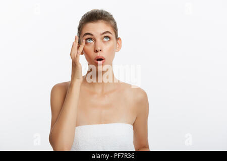 Acne spot pimple spot skincare beauty care girl pressing on skin problem face. Woman with skin blemish isolated, white background. Beautiful young Caucasian female model - Stock Photo