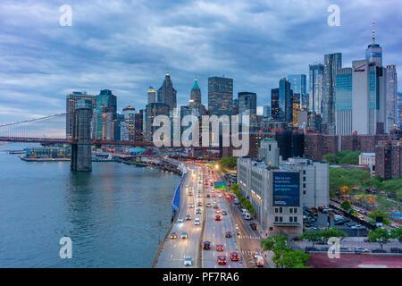 Manhattan skyline and Brooklyn Bridge - Stock Photo