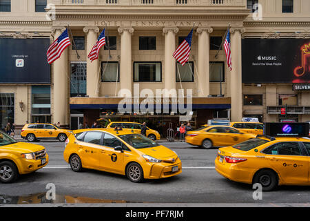 Taxis waiting outside a luxury hotel in New York City - Stock Photo