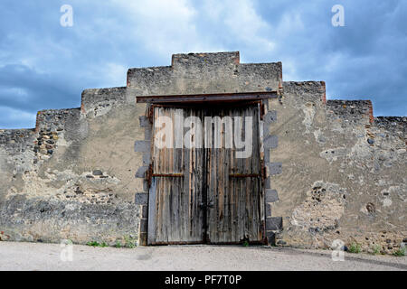 Old wooden door of a barn in Auvergne, France - Stock Photo