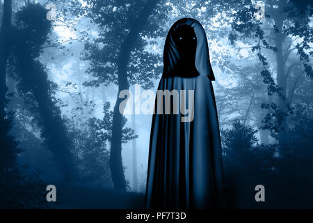 Spooky monster in hooded cloak with glowing eyes in misty forest landscape. Photo toned in blue color - Stock Photo