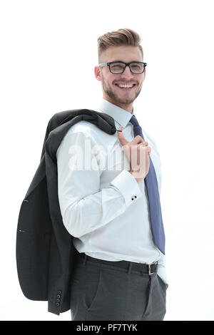 confident businessman holding a jacket over his shoulde - Stock Photo