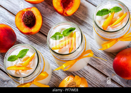 delicious homemade yogurt with pieces of peach, top view - Stock Photo