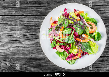fresh salad of prawns and mixed lettuce leaves, top view - Stock Photo