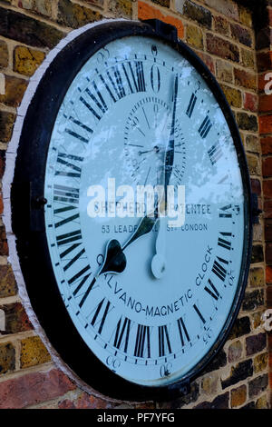Royal Observatory Greenwich. Displaying the Shepherd Gate 24hr clock, Public Measures of Length, and Ordnance Survey Bench Mark. - Stock Photo