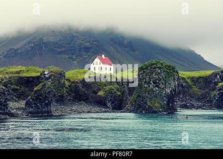 Lonely icelandic house - Stock Photo