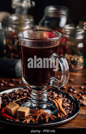 Cup of Coffee on Metal Plate with Beans, Refined Sugar and Cinnamon Stick, Anise and Chili Pepper. - Stock Photo