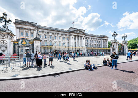London, UK - June 21, 2018: Buckingham Palace with many people, tourists, crowd walking, standing, taking photos, pictures, photographing during summe - Stock Photo