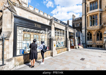 London, UK - June 21, 2018: The Westminster Abbey shop, store entrance with people, tourists standing, looking at window display with gifts, souvenirs - Stock Photo