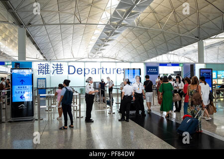 Lantau, Hong Kong  - August 05, 2018 :  Passengers carries luggage at Hong Kong International Airport - Stock Photo