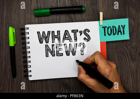 Conceptual hand writing showing What s is New question. Business photo showcasing Asking about latest Updates Trends Happening News Man holding marker - Stock Photo