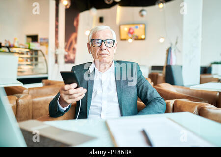 Contemporary Senior Man in Cafe - Stock Photo