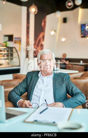 Modern Senior  Businessman Relaxing in Cafe - Stock Photo