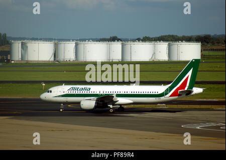 Airbus A319 Ei-EIB of Alitalia taxies at Brussels Zavantem Airport - Stock Photo
