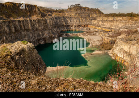 This is a disused quarry located near Wirksworth in Derbyshire. Yes this green lagoon is actually in Derbyshire! - Stock Photo