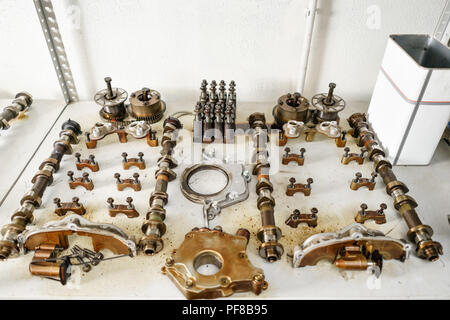 The internal combustion engine, disassembled, repair at car service, overhaul. Repair at car service station. Neatly laid out on the table - Stock Photo