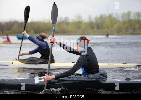 Belarus, Gomel, 25 April 2018. Training in rowing. Athletes rowing with oars - Stock Photo
