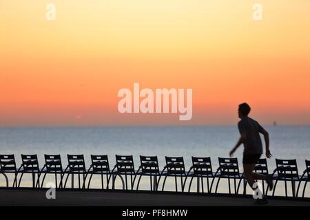 Man jogging by the sea. Nice, Alpes-Maritimes, 06, cote d'Azur, PACA, France. - Stock Photo