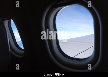 View of clear sky from airplane window i - Stock Photo