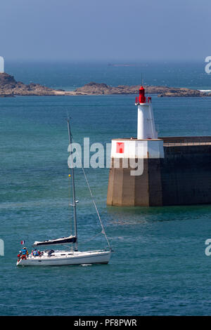 Yacht entering the harbor in the port of Saint Malo on the Brittany coast of northwest France. - Stock Photo